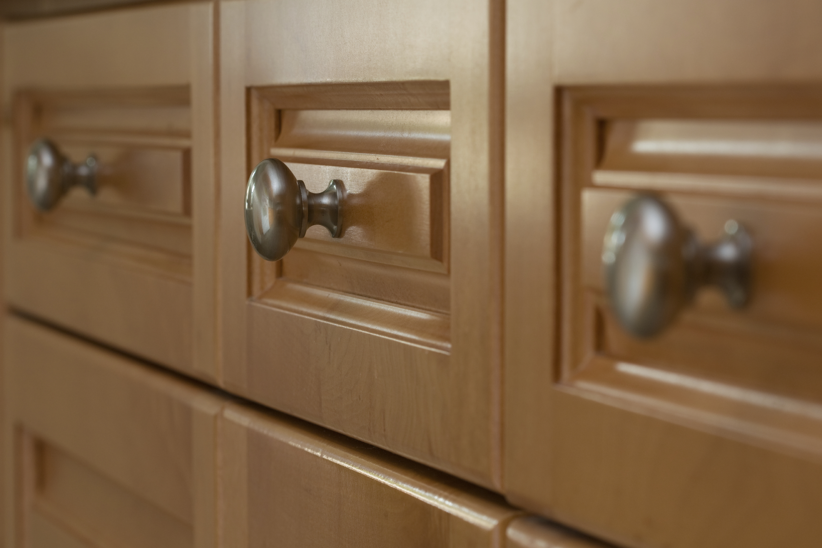 A reader asks what is the correct size for cabinet handles for Kitchen cabinets handles